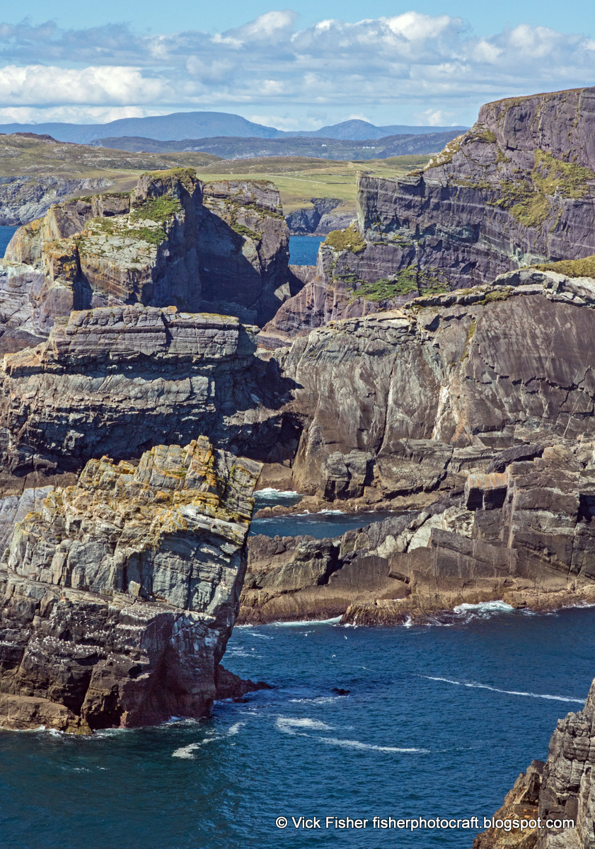 Ireland Irish Mizen Head Europe cliffs beautiful spectacular majestic impressive tall stone stony rock rocky travel tourism vacation adventure nature sea ocean waves blue water wilderness dangerous treacherous forbidding