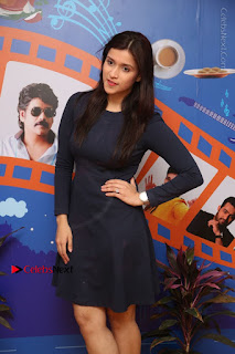 Actress Mannara Chopra Stills in Blue Short Dress at Rogue Song Launch at Radio City 91.1 FM  0042.jpg
