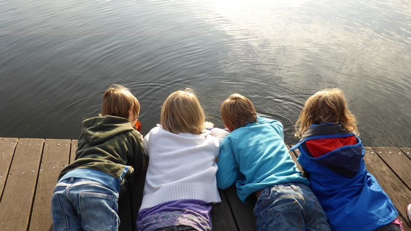 NAMC montessori classroom children with special needs. Kids looking at water on dock