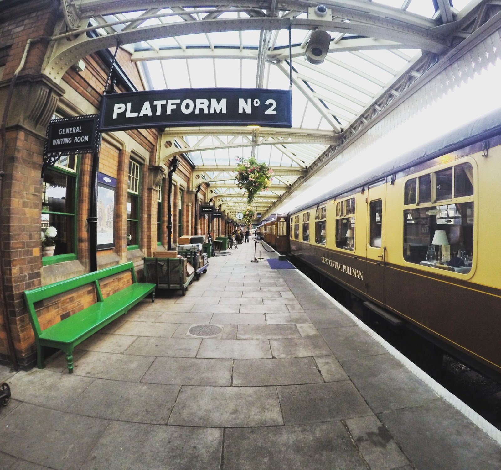 The departure point at Loughborough is a fine example of a 1950s station complete with wooden panelled booking office, a glass, metal and wood canopy, shop, ...