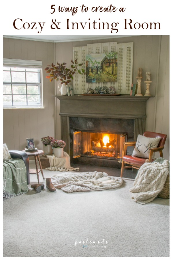 cozy carpeted room with fire in the fireplace