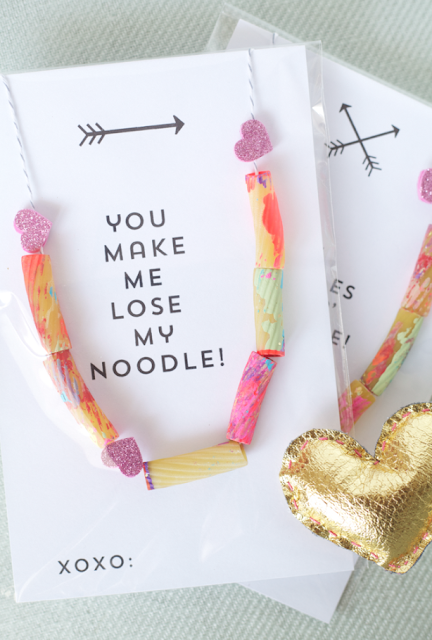 easy craft for preschoolers painted pasta strung on string or yarn tied at ends for cute pasta necklace