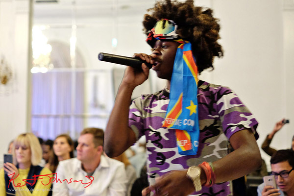 Benny solos on the mic. King Imprint & Kandi Reign Dance It Up LIVE at NYFW - Photographed by Kent Johnson for Street Fashion Sydney.