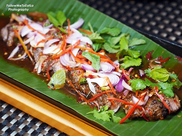 Nam Tok, Grilled black Angus Thai beef salad.