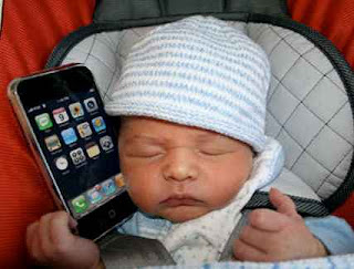 baby holding iphone
