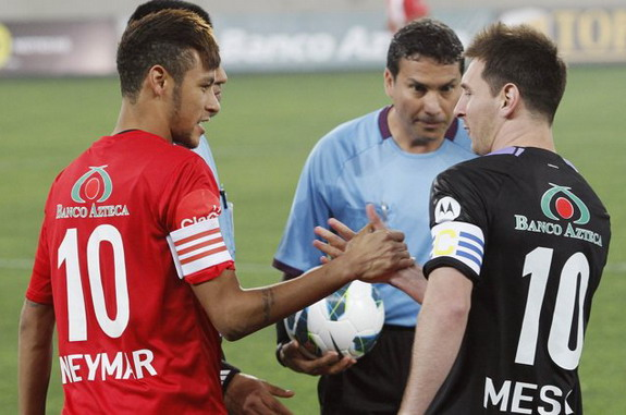 Lionel Messi and Neymar shake hands before a charity match in Lima, Peru