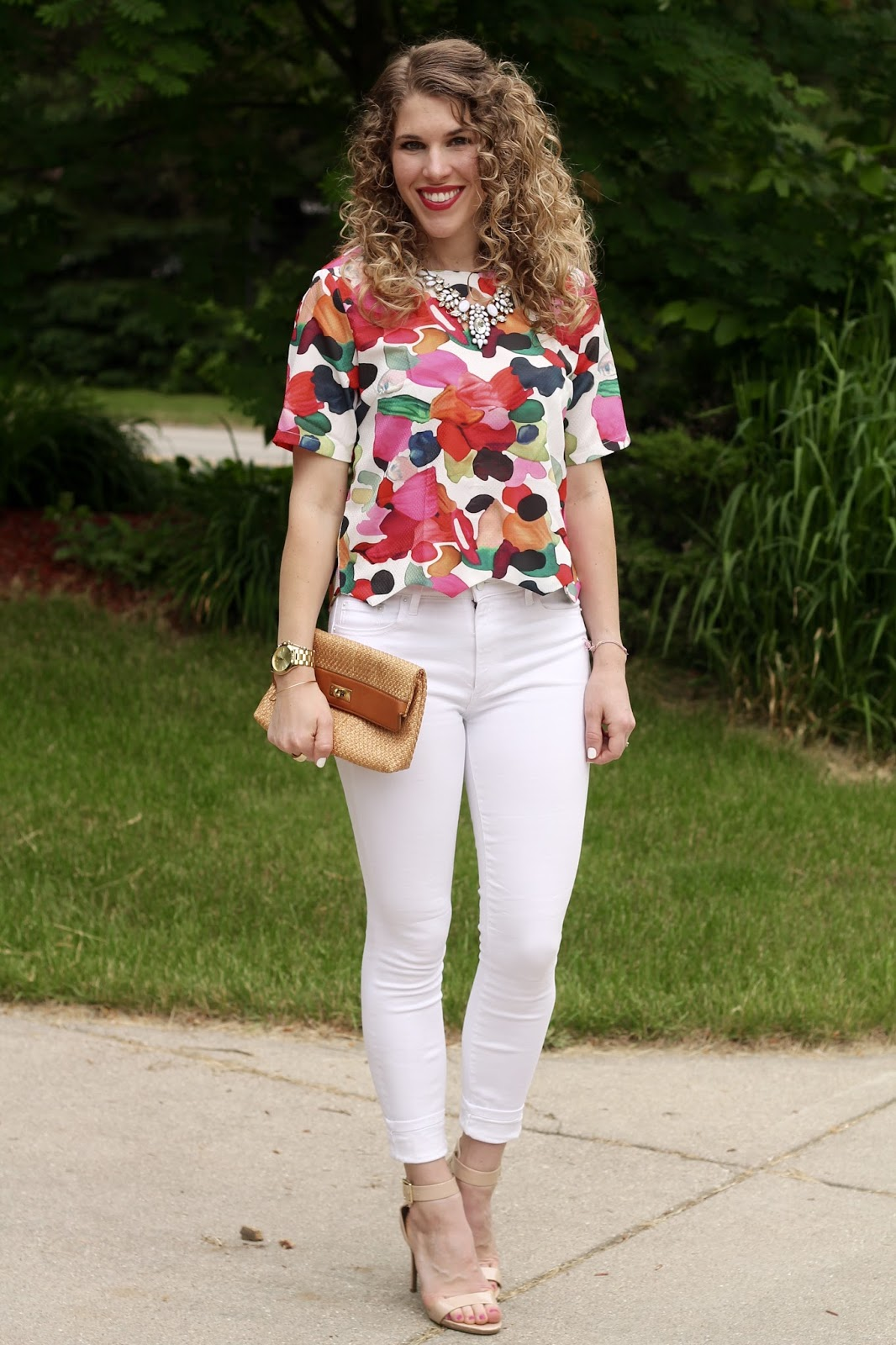 floral crop top, white skinny jeans, nude strappy heels, white statement necklace, straw clutch, spring crop top outfit