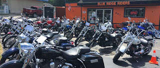 A bunch of motorcycles in front of Blue Ridge Riders