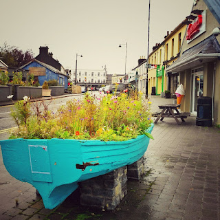 Oughterard, Galway, Ireland, village, road, boat, flowers