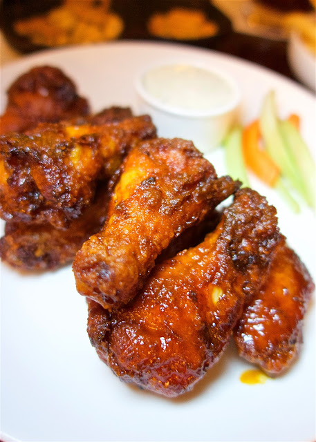 The Wings at Eight (Burger Bar and Sports Lounge) in the Ritz Carlton Amelia Island - THE BEST! Sweet and spicy in one bite.