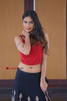 Telugu Actress Nishi Ganda Stills in Red Blouse and Black Skirt at Tik Tak Telugu Movie Audio Launch .COM 0302.JPG