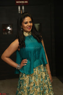 Anchor Srimukhi in green sleeveless top and skirt at O Pilla Nee Valla Movie Audio Launch Feb 2017 104.JPG