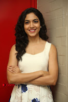 Actress Ritu Varma Stills in White Floral Short Dress at Kesava Movie Success Meet .COM 0092.JPG