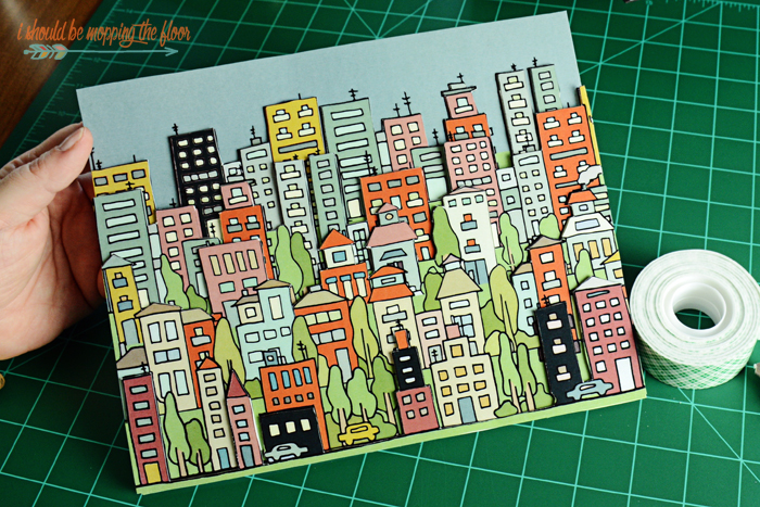 DIY 3D Artwork with Free Printable Background | Download this cityscape and learn how to create this fun 3 dimensional piece of art with simple mounting tape and cutting.