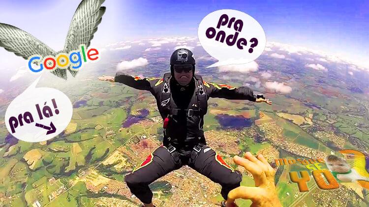 Na foto, é possível ver um paraquedista caindo, perguntando pro Google onde deve ir, e o Google indica o nosso blog para que ele tenha um bom pouso