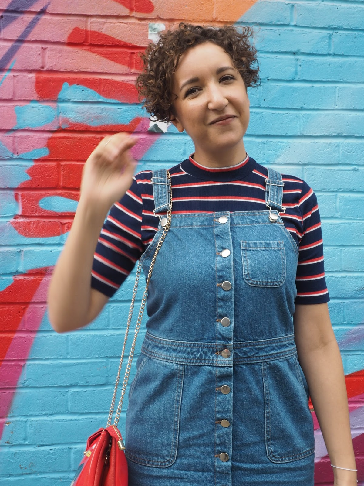Fashion blogger wearing a denim pinafore dress