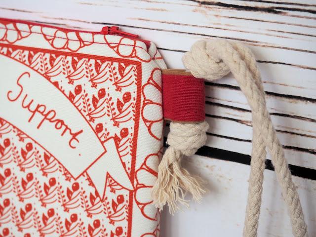 Alexander Henry, printed cotton, Oxford cloth, tea towel, cosmetic bag, wristlet, travel document holder, everyone needs support, Etsy, vegan business, micro business, pom-pom trim, Simplicity pom-poms, bra, cotton rope
