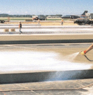 Hydrocarbon resin with aluminum pigment is spraying over concrete after stopping bleeding