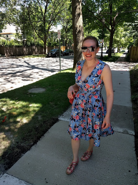 Full-length view of me walking down the sidewalk in my wrap dress.