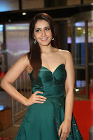 Raashi Khanna in Dark Green Sleeveless Strapless Deep neck Gown at 64th Jio Filmfare Awards South ~  Exclusive 121.JPG