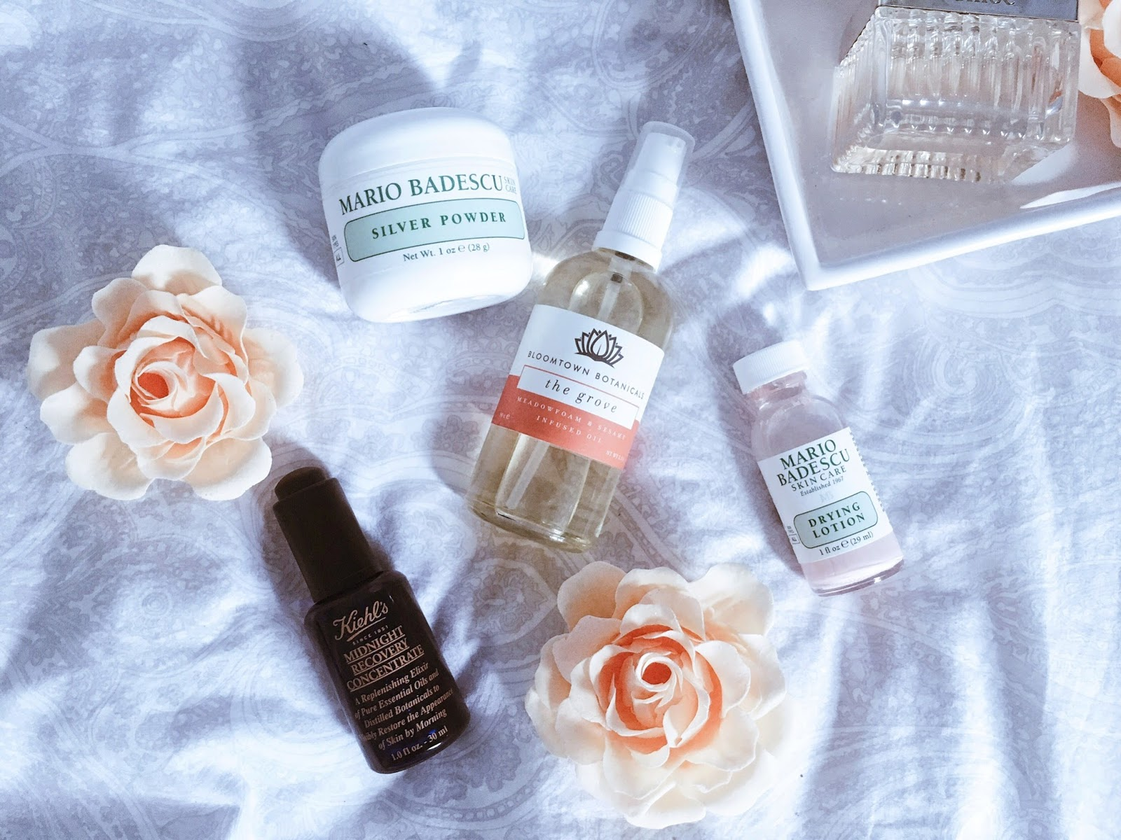 flat lay of skin care on duvet