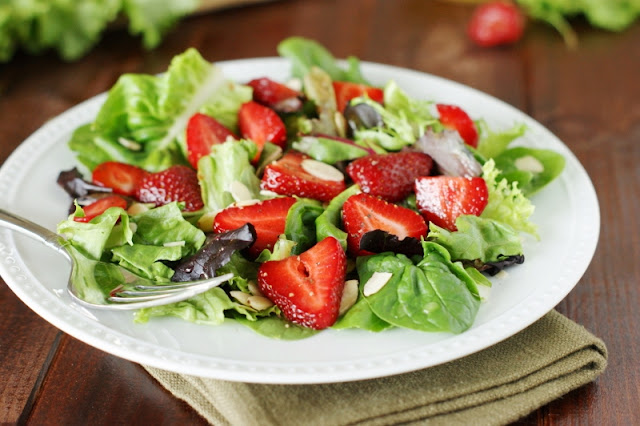 looking fresh strawberries are starting to brand their appearance inwards grocery stores hither Strawberry & Greens Salad amongst Honey Vinaigrette