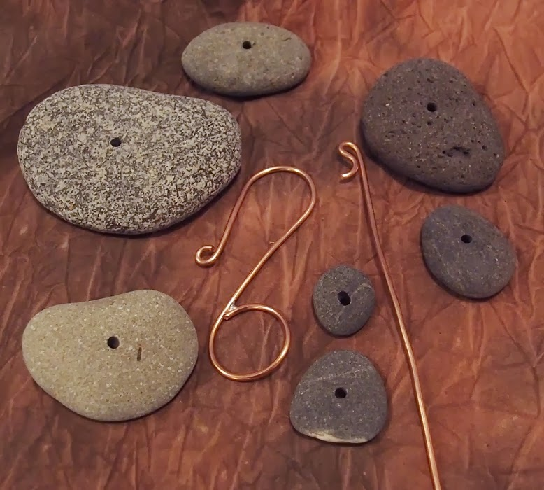 Drilled beach stones and soldered copper hook