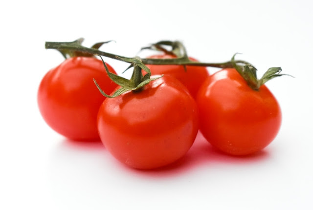 a close up of cherry tomatoes