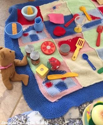 Toy picnic set up by a child
