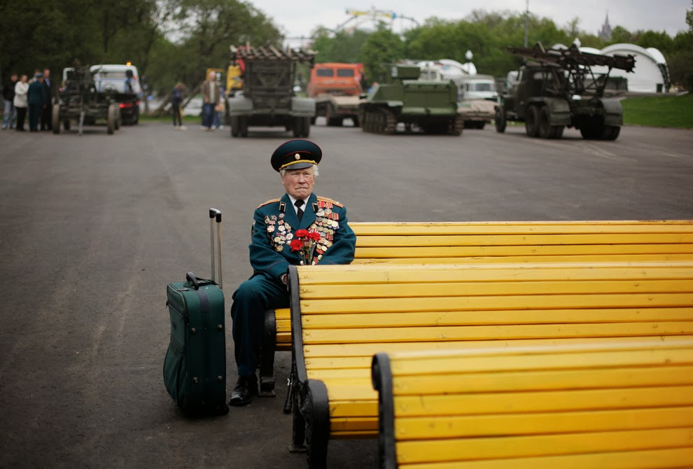 World War II veteran from Belarus Konstantin Pronin, 86, sits on a bench as he waits for his comrades at Gorky park during Victory Day in Moscow, Russia, on Monday, May 9, 2011. Konstantin comes to this place every year. This year he was the only person from the unit to show.