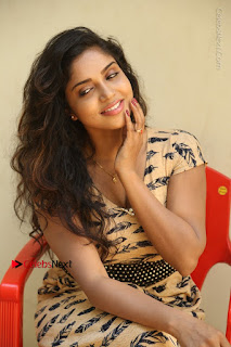 Telugu Actress Karunya Chowdary Stills in Short Dress at ATM Not Working Press Meet  0210.jpg