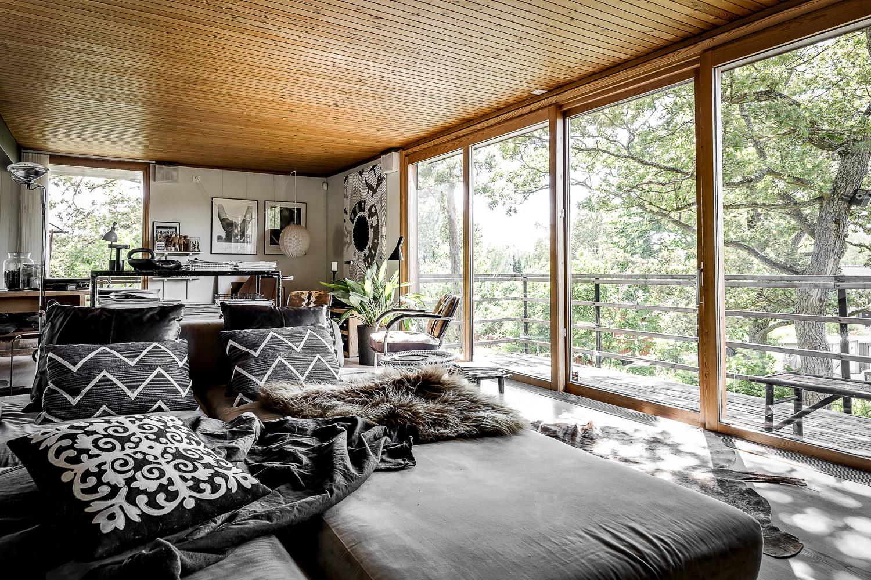 Scandinavian villa with oriental and rustic decor. dark gray pillows, industrial lamp, photography