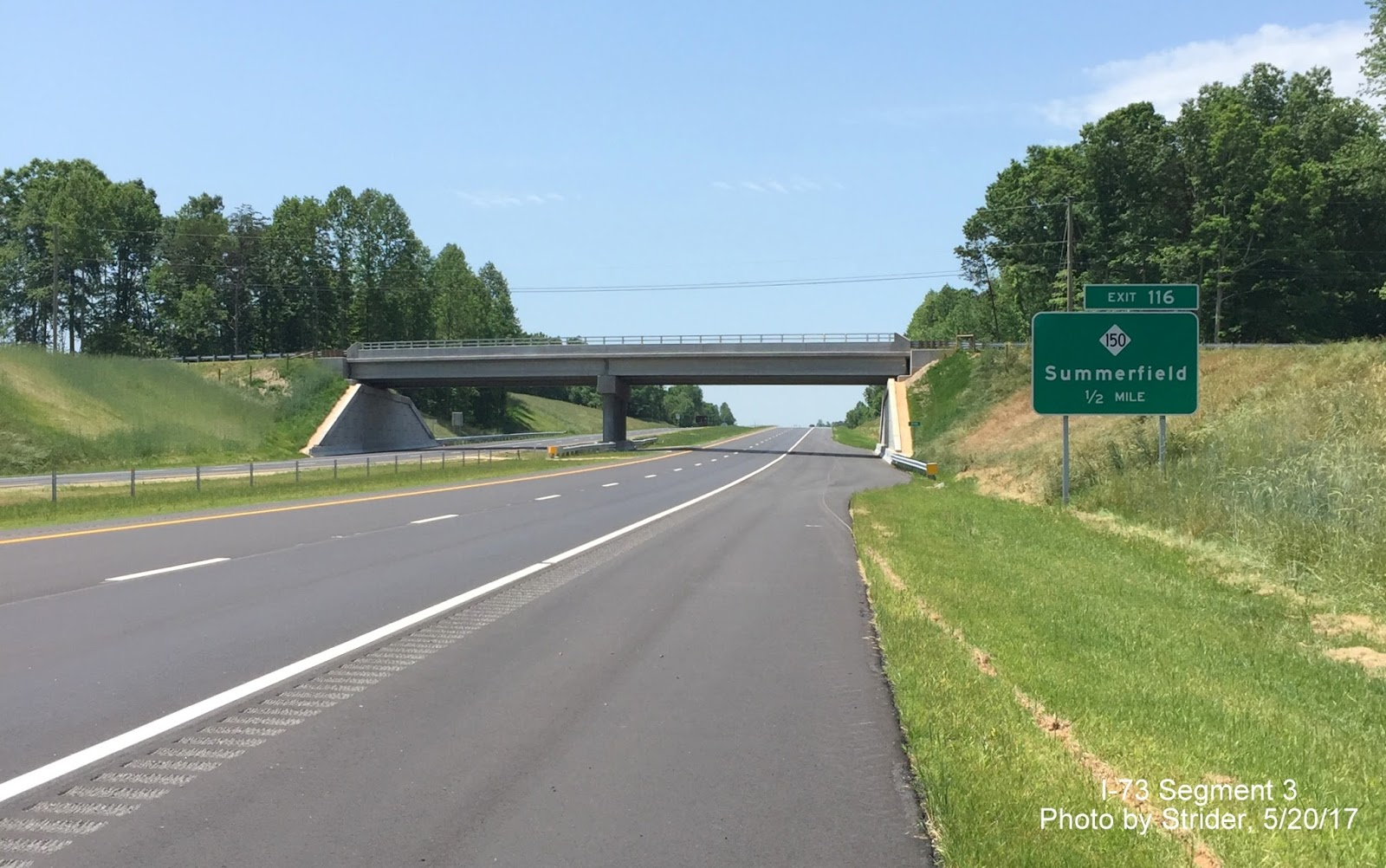 1 2 mile advance sign for nc 150 summerfield exit on i 73 south