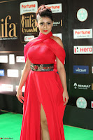 Apoorva in a Stunning Tight Leg Split Sleeveless Red Gown at IIFA Utsavam Awards 019.JPG