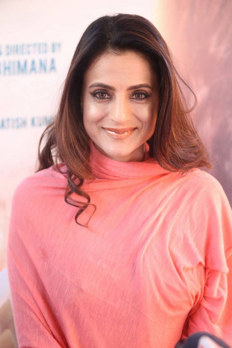 Actress Ameesha Patel Long hair Stills In Pink Dress