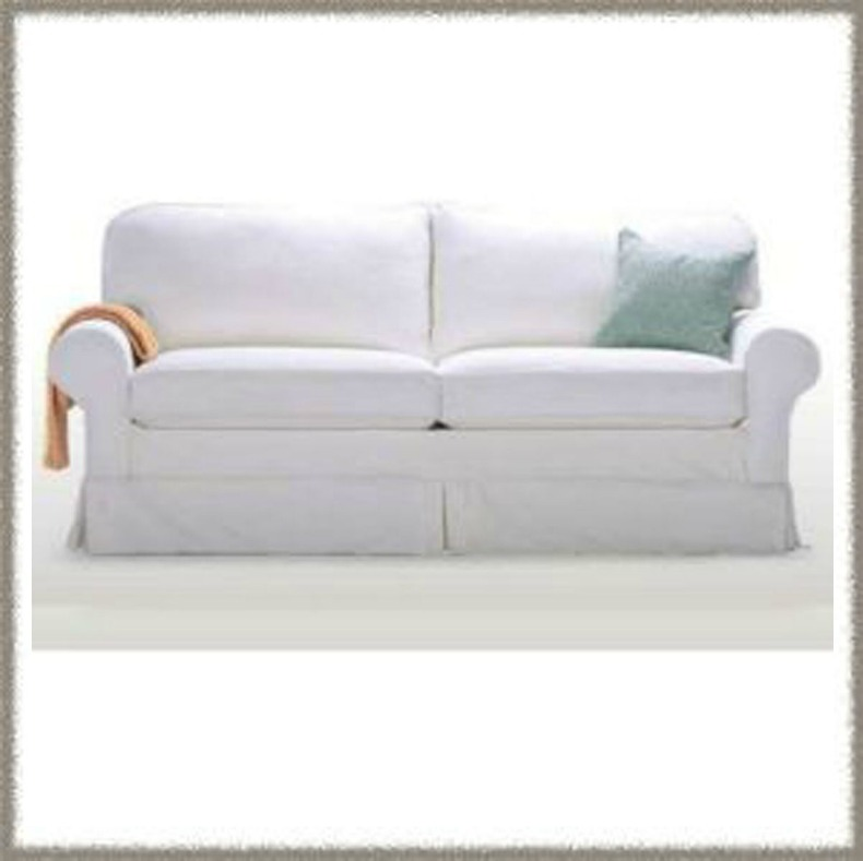 White slipcover sleeper sofa