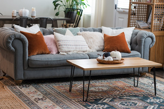 Lots of textural pillows on a chesterfield sofa