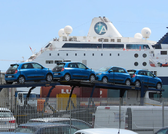 Four Renault Twingo on a car carrier, port of Livorno