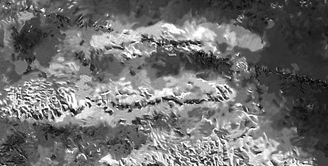 The trio of ridges on Titan known as Mithrim Montes is home to the hazy Saturnian moon's tallest peak. Credits: NASA/JPL-Caltech/ASI