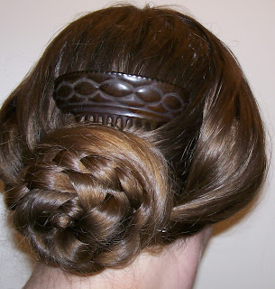 1855 hairstyle: wide side bands with back braided bun.
