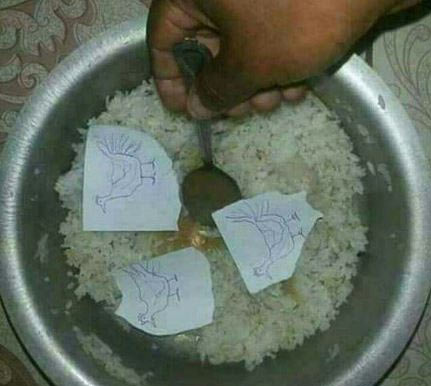 LMAO! Viral picture of a Nigerian eating rice & chicken during recession