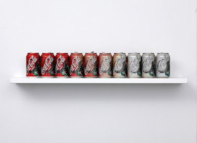 Things organised neatly coke cans