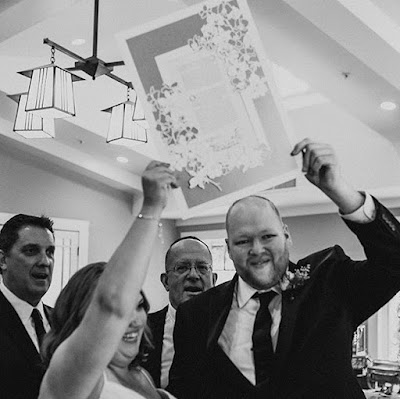 Courtney & Saul proudly displaying their handmade papercut ketubah by Woodland Papercuts. The Jewish wedding tradition of commemorating for prosperity the couple's marriage pledge to each other. Photo by Vivienne Tyler Photography.