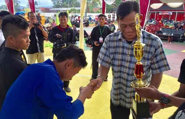 paguron pencak silat merak emas juara di kemenpora cup