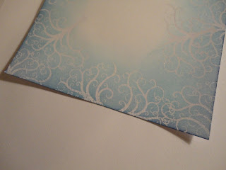 Blue swirl resist embossed background