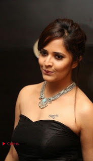 Telugu Anchor Actress Anasuya Bharadwa Stills in Strap Less Black Long Dress at Winner Pre Release Function  0039.jpg