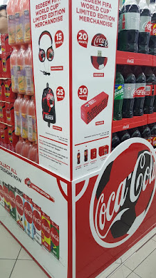 World Cup signage for Coca-Cola on the shelves. Taken June 1.