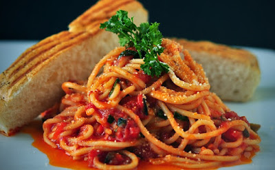 Pile of Spaghetti with a no-meat sauce and White Bread