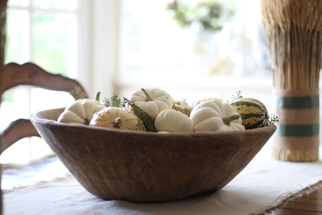 fall home tour antique dough bowl filled with gourds and baby pumpkins autumn decor
