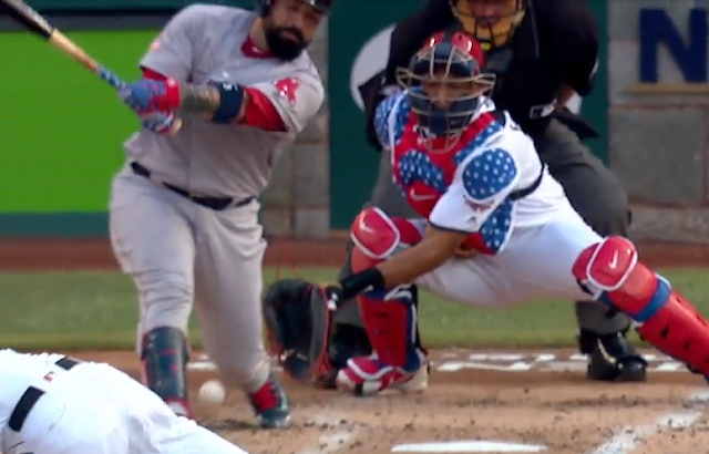 Sandy Leon swings at pitch that goes through his legs